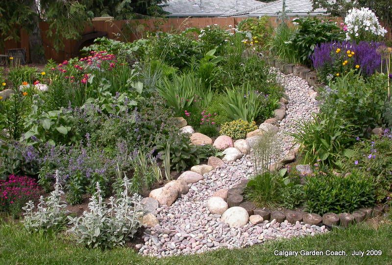 Dry Stream Bed On Slope Hillside Landscaping Landscaping With Rocks Dry Creek