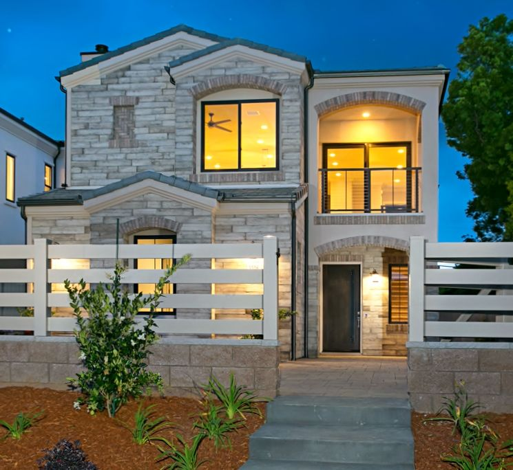 Two story mini-estate with natural stone exterior and ...