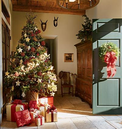 the christmas tree right inside the front door is such a welcoming display to greet guests and establish a festive tone for the house in a