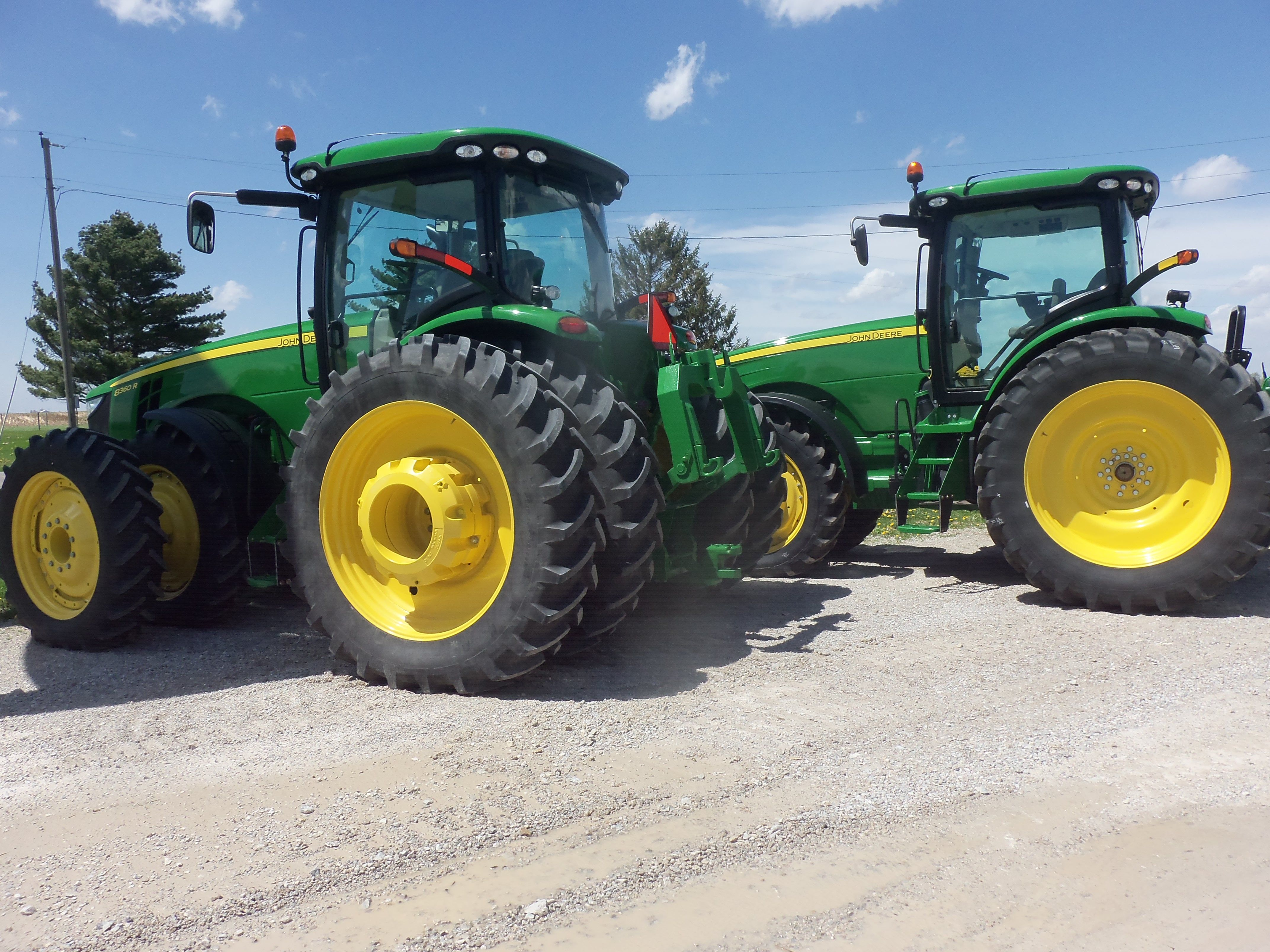 Opposite ends of the John Deere 8R Series tractors.192 hp John Deere 8235R on right & 321 hp 8360R on left.The 8235R has got the same hp as the 4850 from 30 years ago.The engine hp as the 8560 of 25 years ago