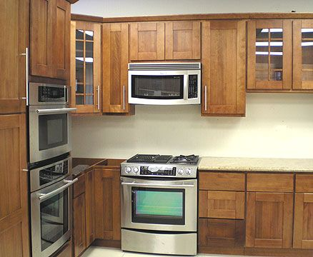 Shaker Style Kitchen Cabinets With Stainless Steel Appliances Photo