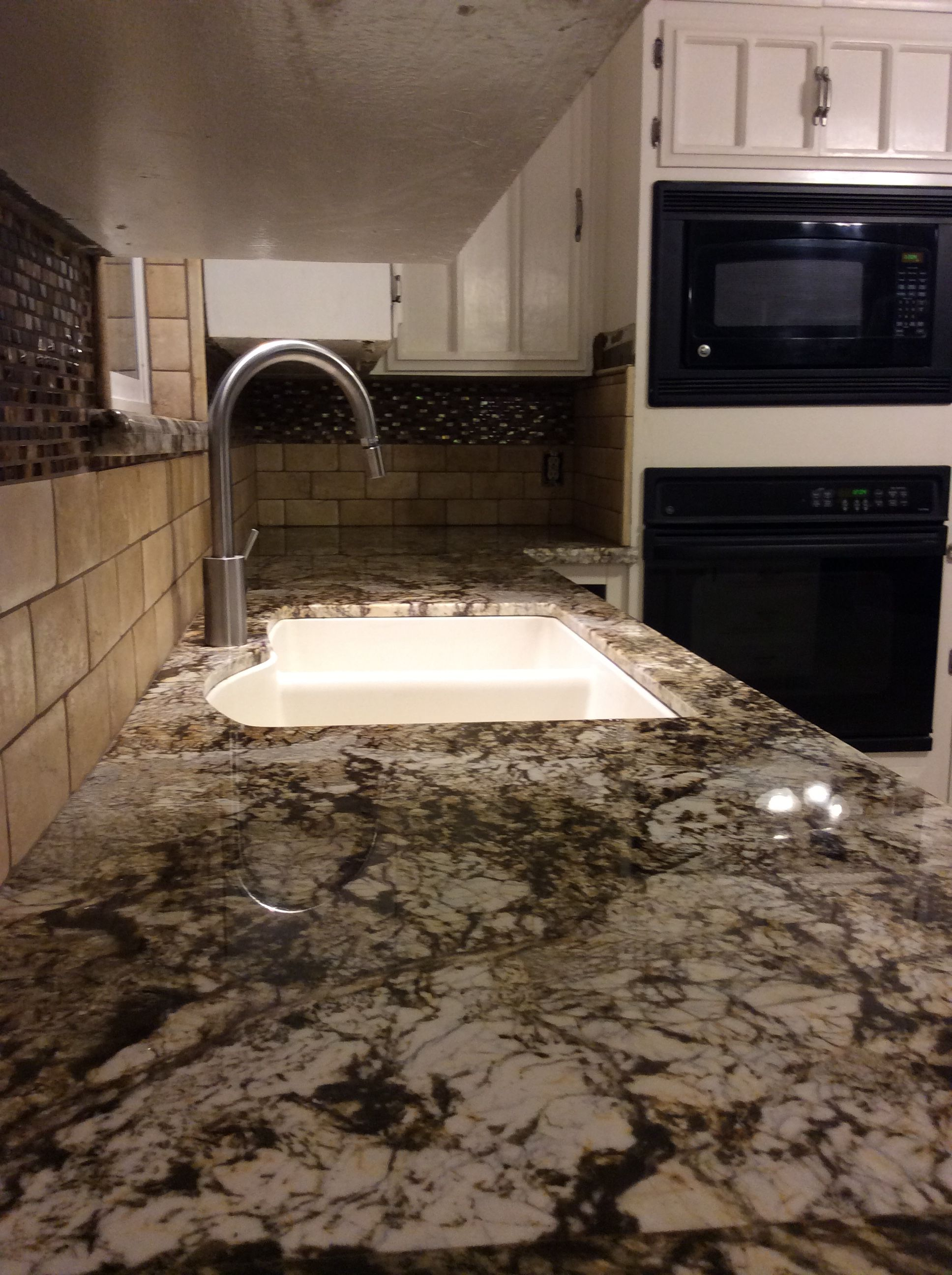 Normandy Granite Countertops From Our Fresno Location Paired With A Limestone Backsplash