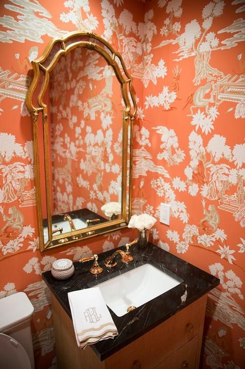 Orange Chinoiserie Powder Room Features Walls Clad In Toile Wallpaper Lined With A Gold