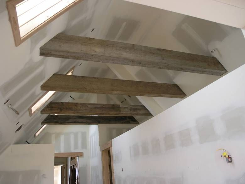 Weathered beams timbers guest loft in the vaulted for Vaulted ceiling with exposed trusses