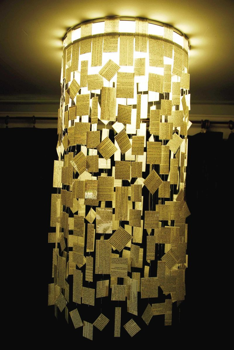 Laminated paper chandelier bookish crafts pinterest paper beautiful hanging paper chandelier using cut up pieces of book pages arubaitofo Choice Image