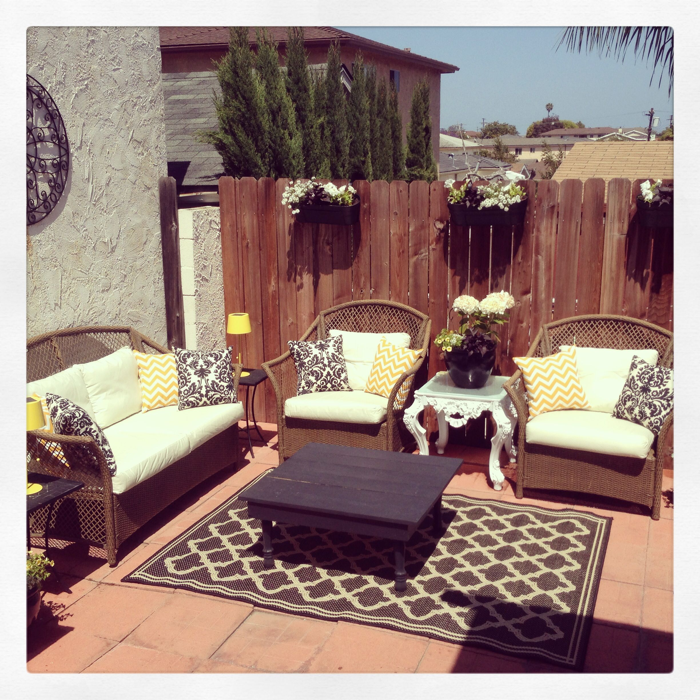 Yellow black and white outdoor patio decor