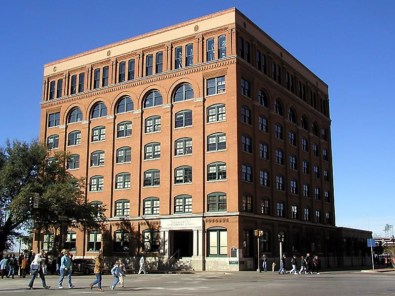 The Texas School Book Depository, now known as the Dallas County Administration Building, is a seven-floor building facing Dealey Plaza in Dallas, Texas, United States. The building is most notable as the vantage point of the assassination of John F. Kennedy on November 22,