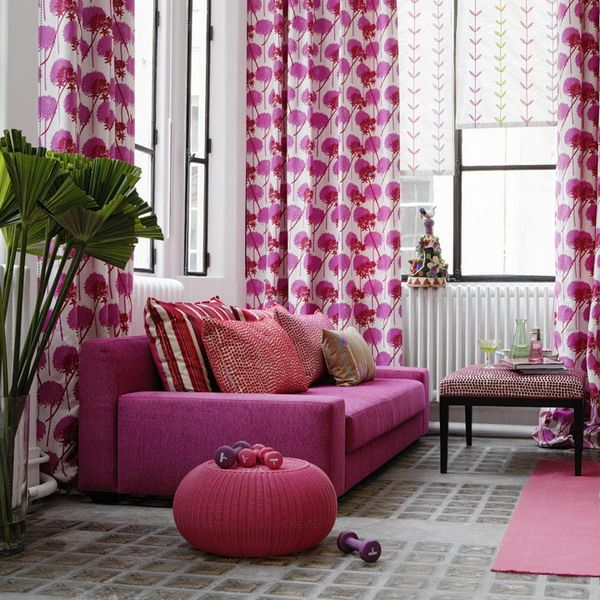 I love this color palette - they've gone pink, but it's not overpowering.   I don't think I would've had the courage to add that much pink to a room, but it really works!