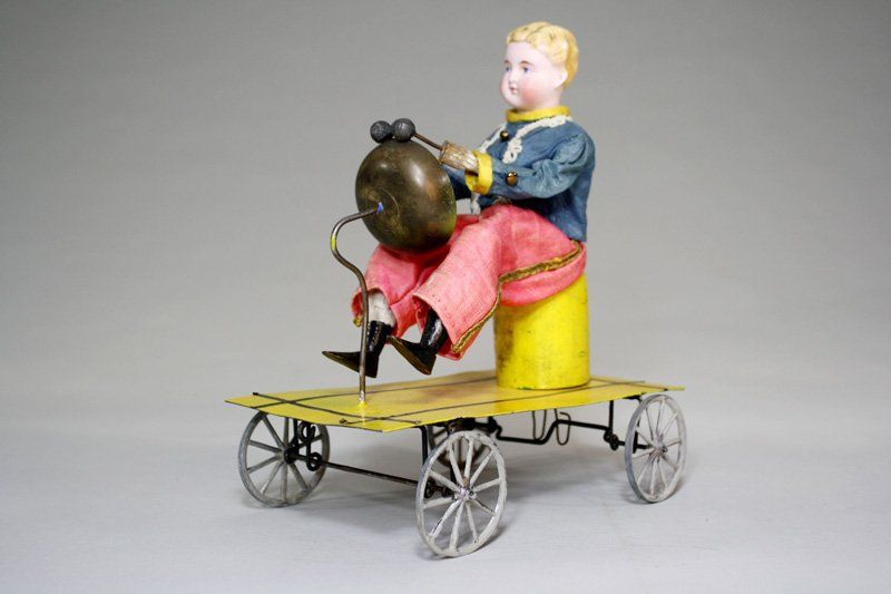 Boy Playing Drum Bell Toy Cast Iron