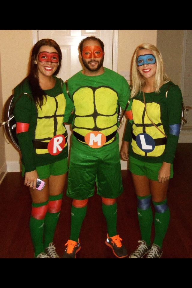 DIY Ninja Turtle Costumes for under $30 green shirts (Purchased at Walmart) painted yellow with black outline for chest piece of shell. Green athletic shorts. Black ribbon hot glued to felt circle with cut out felt letter for belt. (Supplies Purchased at hobby lobby.) Green knee high socks (purchased at Sports Authority.) Colored athletic wrap for knee and elbow pads.