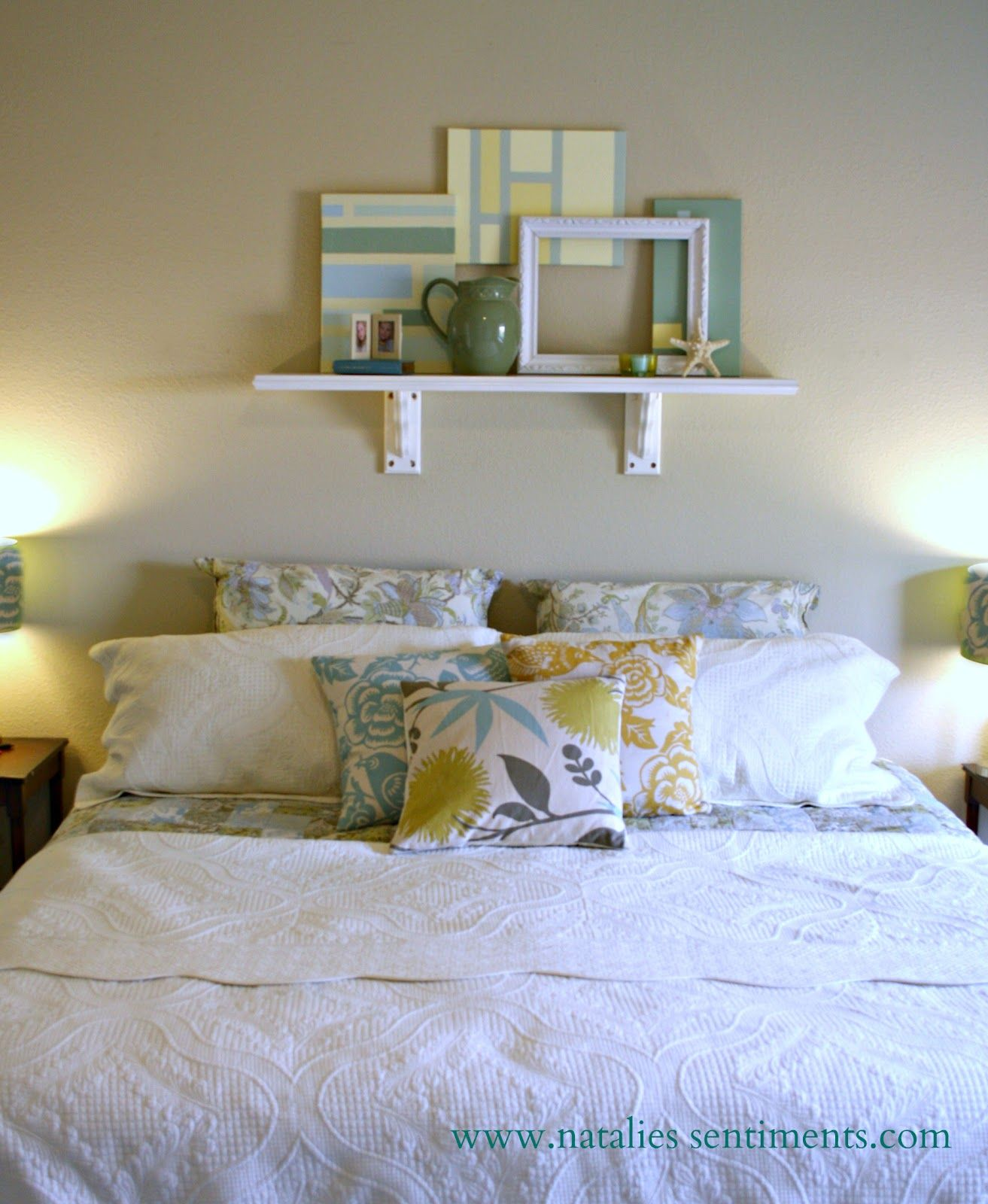 Simple canvas art and a pretty shelf above the bed (With