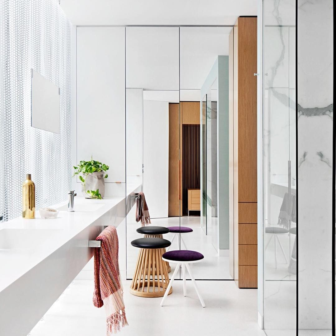 Quirky accessories, a steel curtain and dazzling white interiors ...