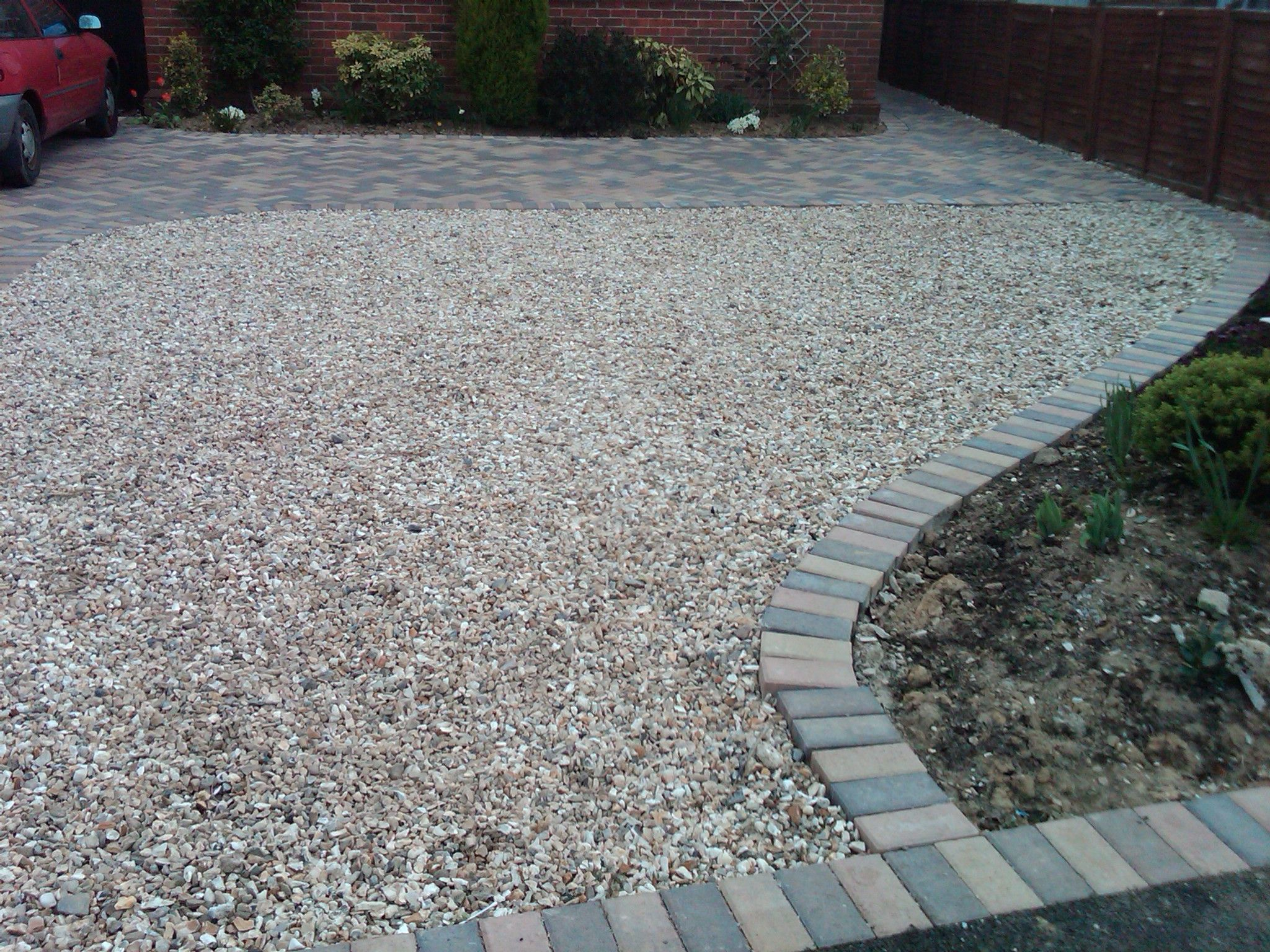 Gravel Driveway With Paver Edge Google Search Driveway Landscaping Landscaping Costs Front Yard Landscaping