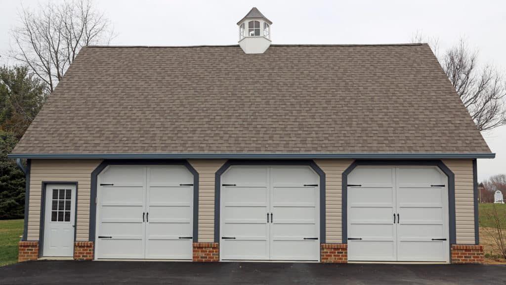This Detached Garage Features Courtyard Collection Garage Doors Installed By Overhead Door Company Of Washi Garage Doors Residential Garage Doors Overhead Door