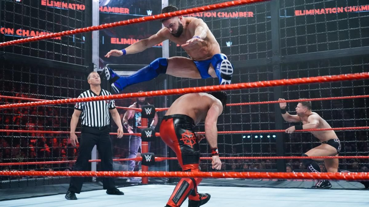 Photos Raw Superstars Slug It Out In Barbaric Elimination Chamber Match For Right To Challenge Lesnar Wwe Fighting Finn Balor Brock Lesnar