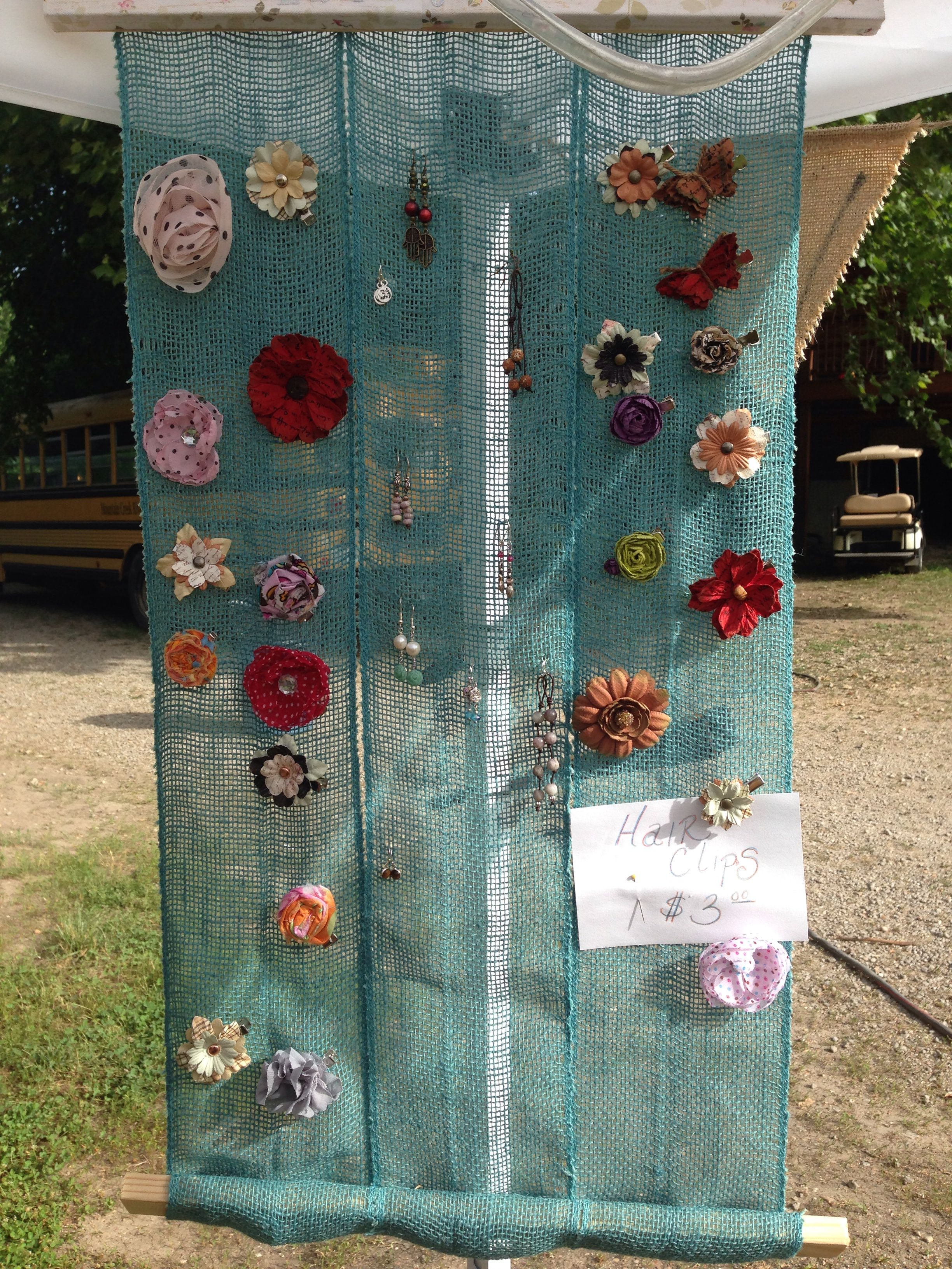 I used burlap and scrap wood to create a backdrop for earrings and hair clips.