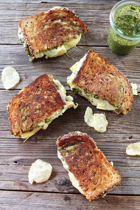 Pesto, Artichoke, and Havarti Grilled Cheese Recipe on twopeasandtheirpod.com This simple grilled cheese is loaded with flavor.