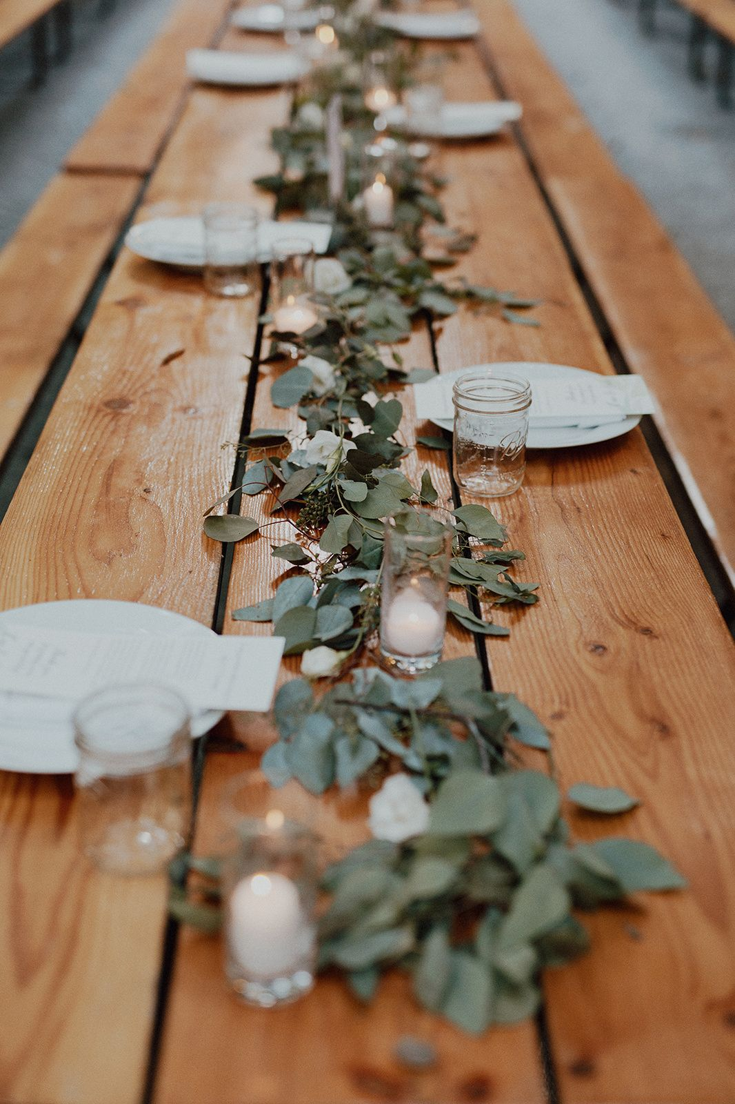 Loose Greenery To Create A Garland Effect On Wood Picnic Table With White Accent Flowers Ru Wedding Picnic Table Decor Picnic Table Wedding Picnic Table Decor