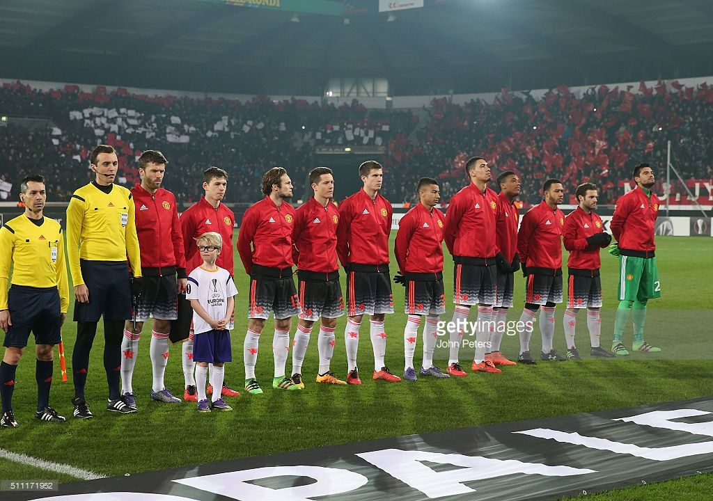 Michael Carrick, Donald Love, Daley Blind, Ander Herrera, Patrick McNair, Jesse Lingard, Chris Smalling, Anthony Martial, Memphis Depay, Juan Mata, Sergio Romero) line up ahead of the UEFA Europe League match between FC Midtjylland and Manchester United on February 18, 2016 at MCH Arena in Herning, Denmark.