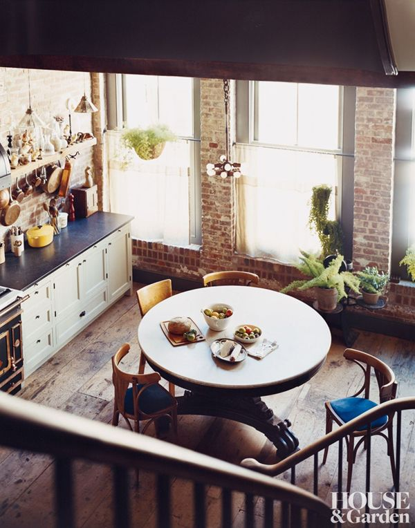 Love This Dark, Cozy Manhattan Home. The Loft Apartment Features Exposed  Brick Walls And White Painted Cabinets.