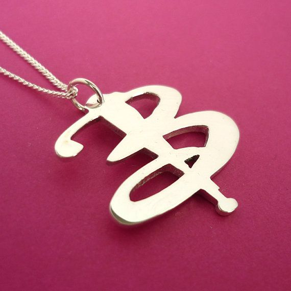 Buffy! <-- I like this because it could be a monogram of my maiden initial. Secret nerd jewelry!