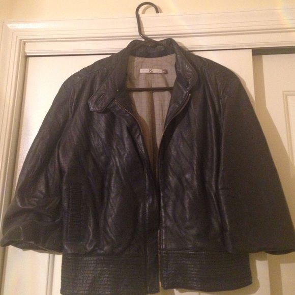 Adorable Mike & Chris genuine leather jacket Navy cropped leather jacket. Quarter length sleeves. Perfect condition Mike & Chris Jackets & Coats