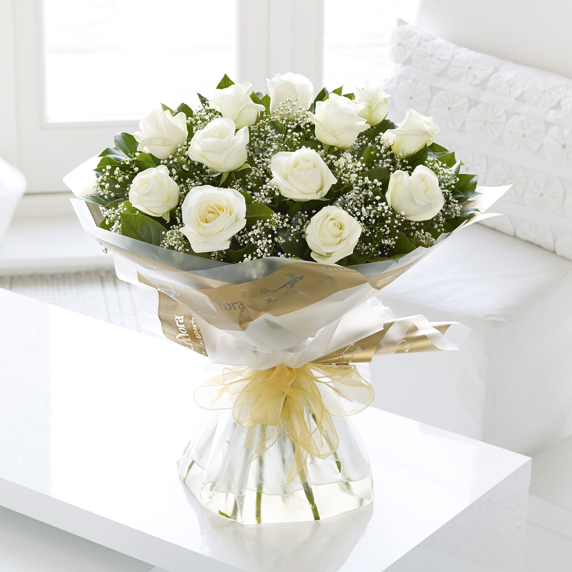 Heavenly white roses handtied with gypsophila and salal