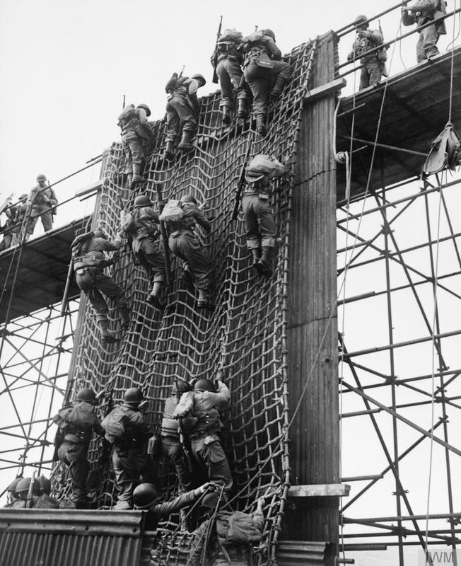 OPERATION OVERLORD (THE NORMANDY LANDINGS): D-DAY 6 JUNE 1944: US troops train on how to climb down the side of bigger ships onto landing craft. What's lacking from this training is the movement of both large and small vessels in choppy seas.