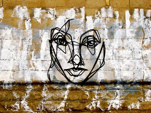 """ANSER: Known as the """"Mysterious Date,"""" these faces show off ANSER's ability to fuse """"high art"""" portrait techniques with street-graffiti bombing tactics."""