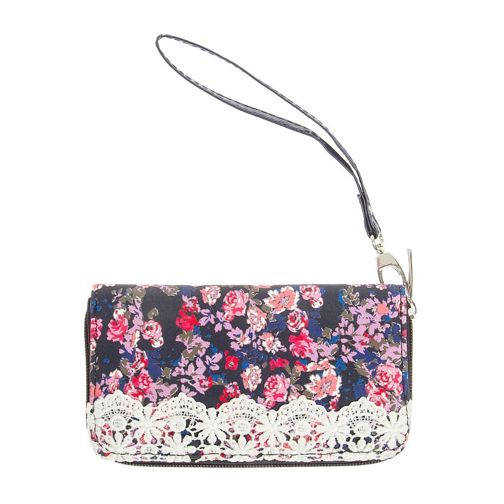 This floral wristlet is everything you need. Features chic