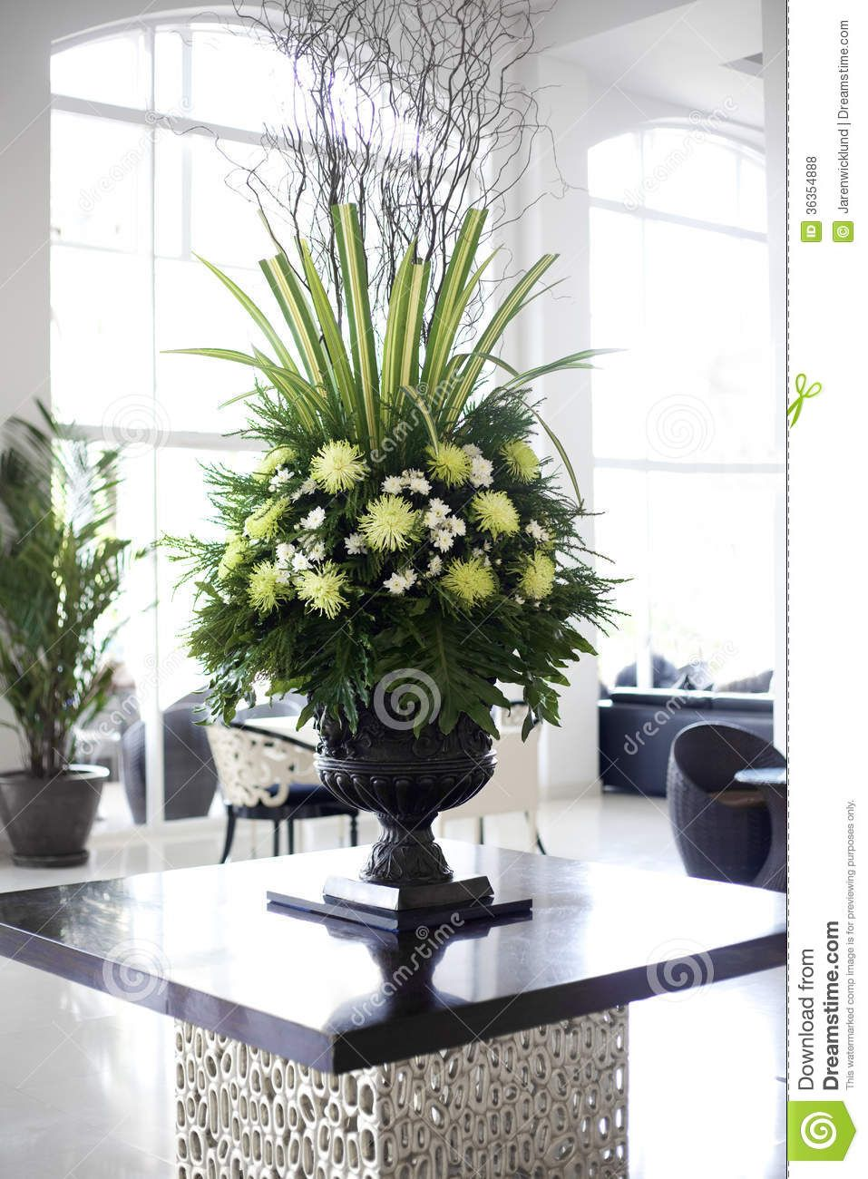 Beautiful flower arrangement in large foyer royalty free for Foyer flower arrangement