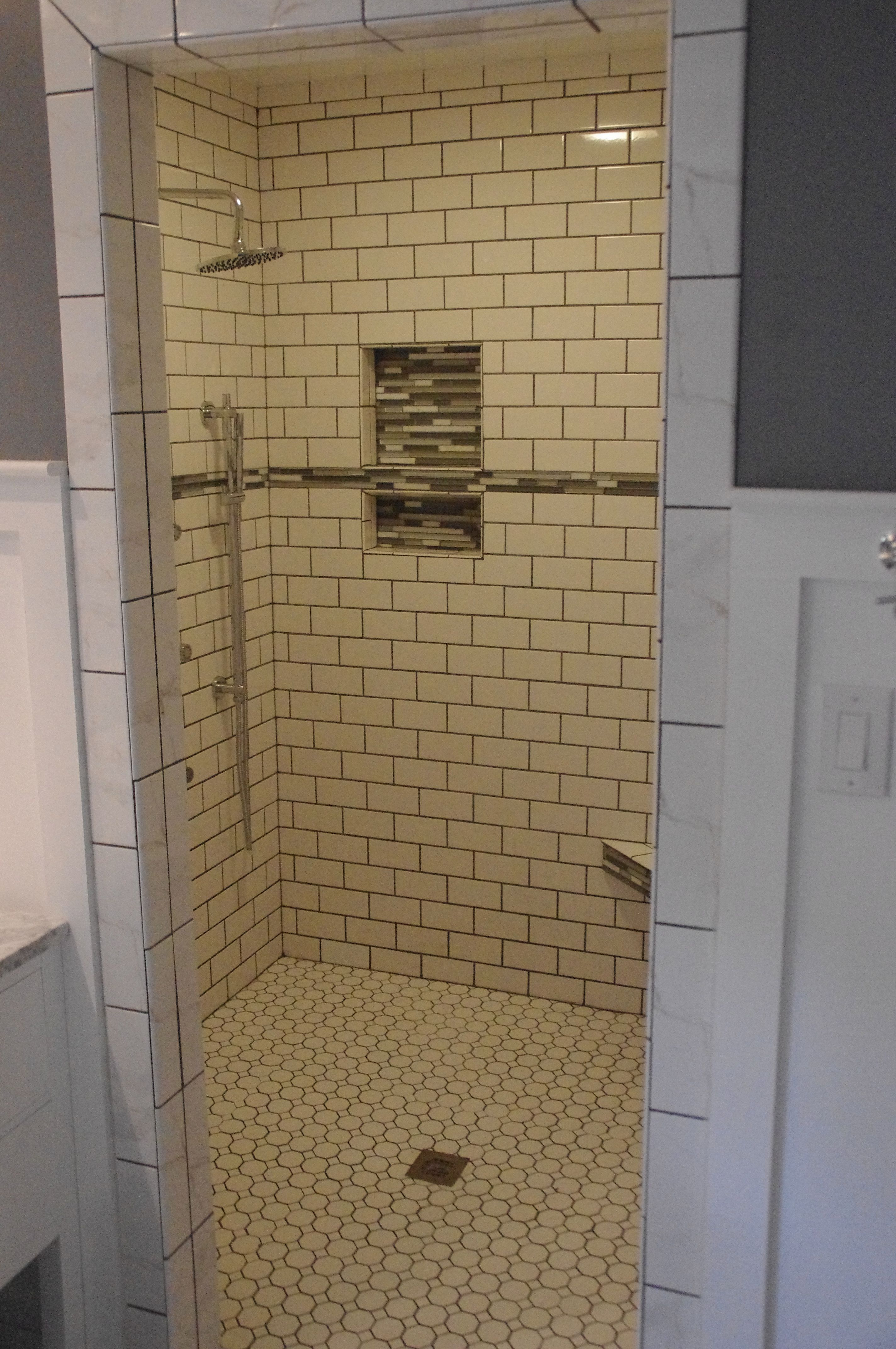 White subway tile shower with glass inserts after bathroom makeover ...