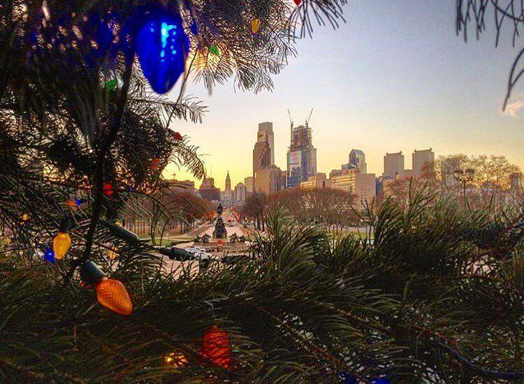 Philadelphia skyline through Holiday tree. Photo by @gmunnies