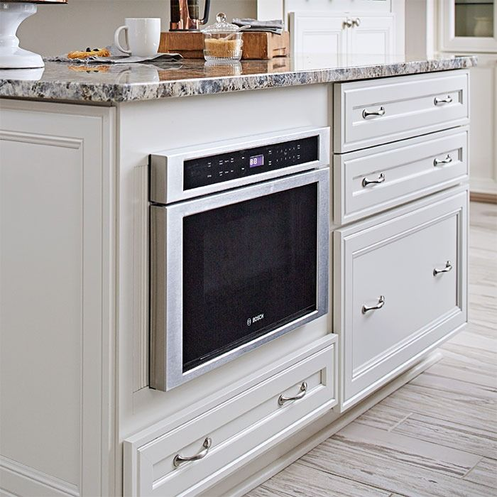 A Large Kitchen Island Or Peninsula Provides Valuable Storage Space