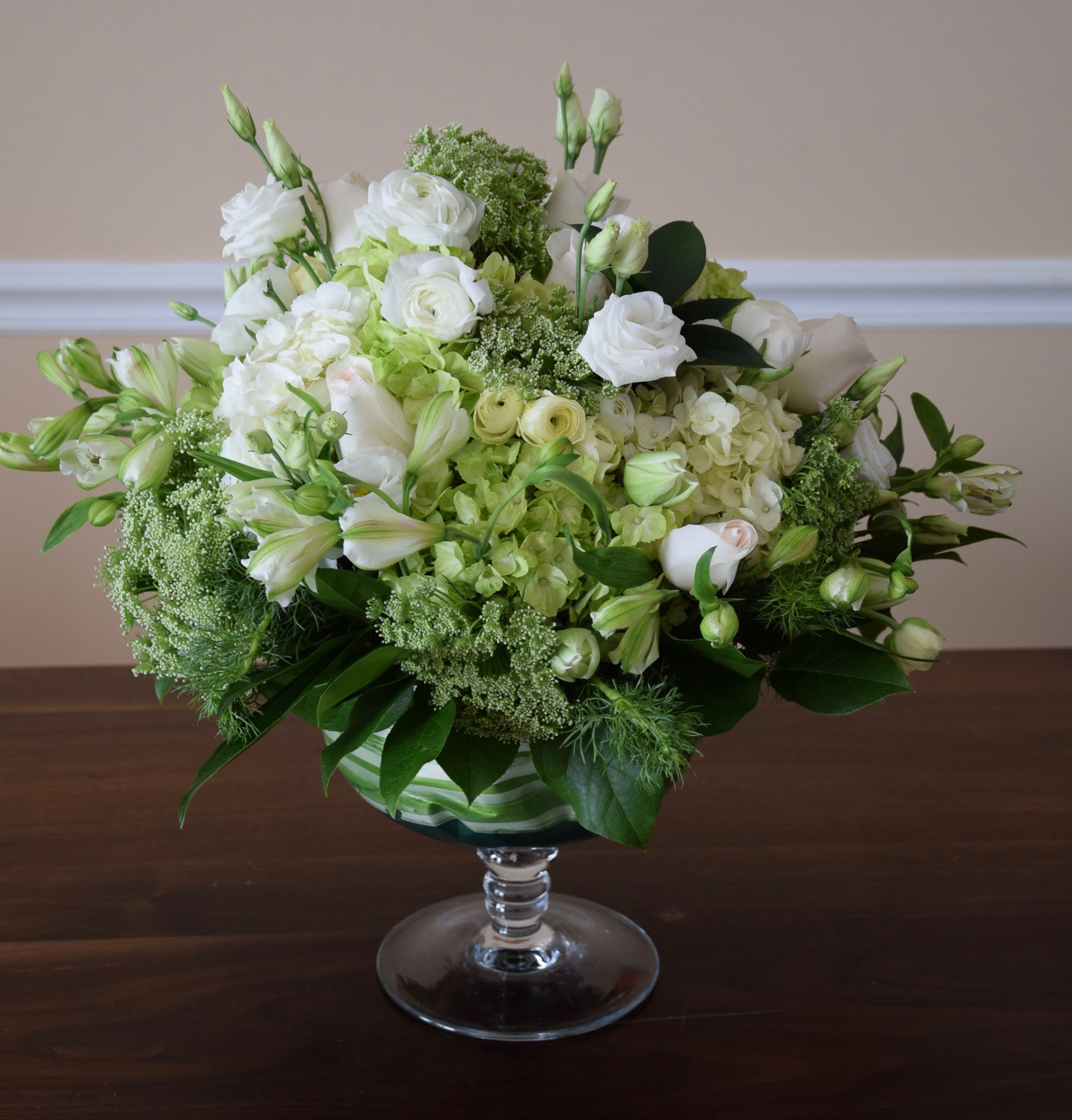 Large table centerpiece in white and green colors as a