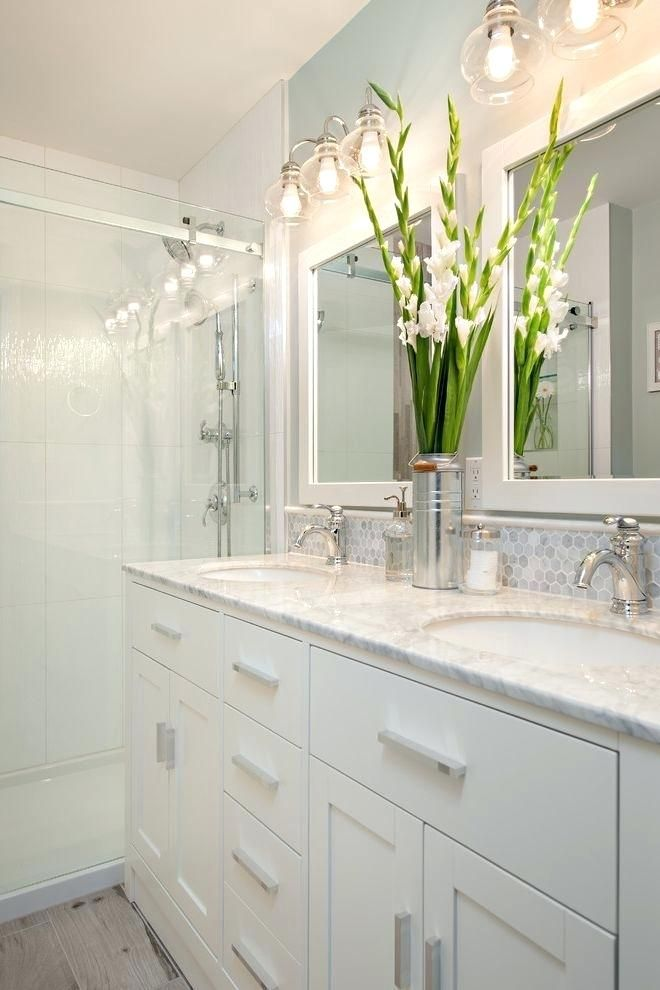 Modern Ensuite With Double Vanities And Floor To Ceiling Tiles In