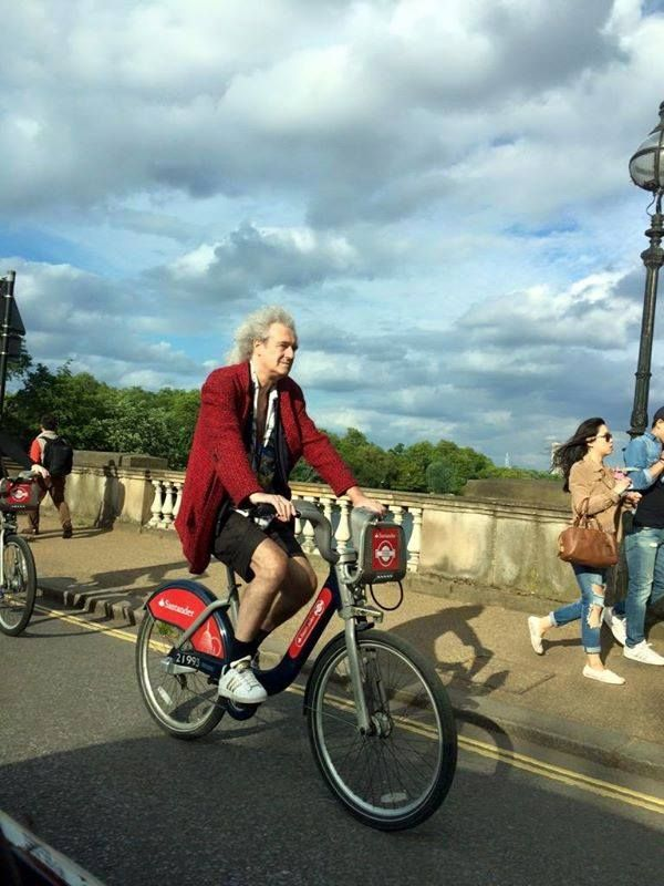 Brian May Of Queen On Santander London Hire Bike Crossing Richmond