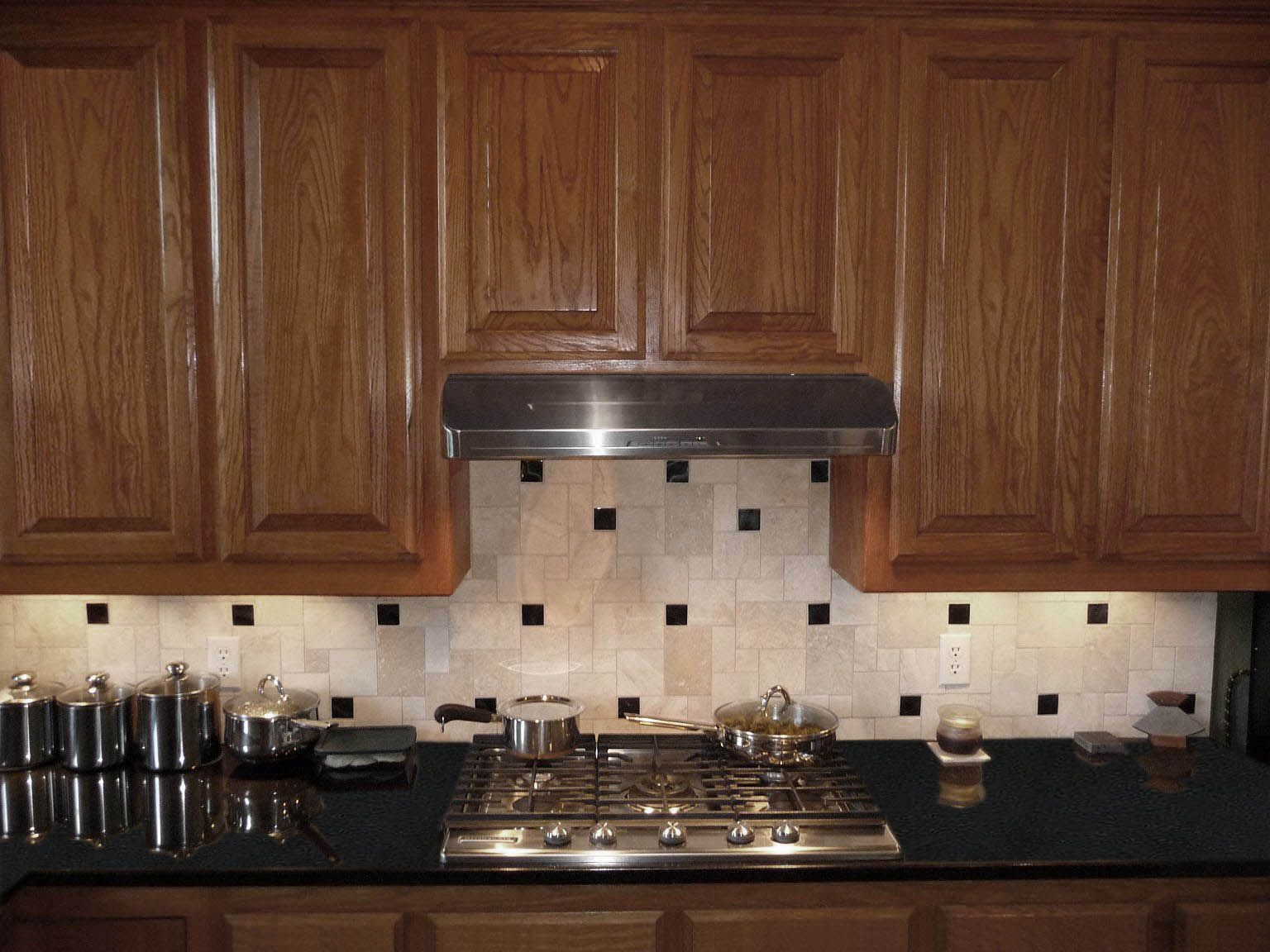 Black Premium Granite Countertops with a Medium Light oak