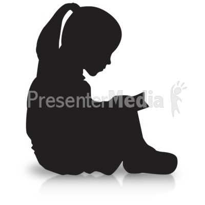 a silhouette of a girl reading while sitting down