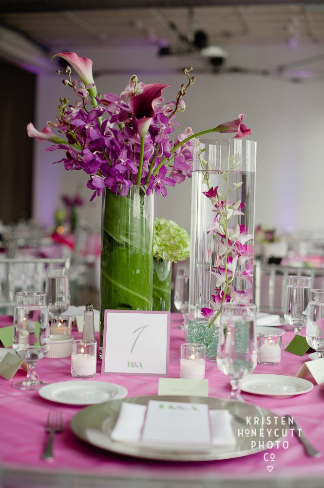 Tall glass cylinder centerpiece with submerged purple