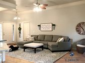 Sherwin Williams Agreeable Gray in living room with gray sectional couch and are... #sherwinwilliamsagreeablegray