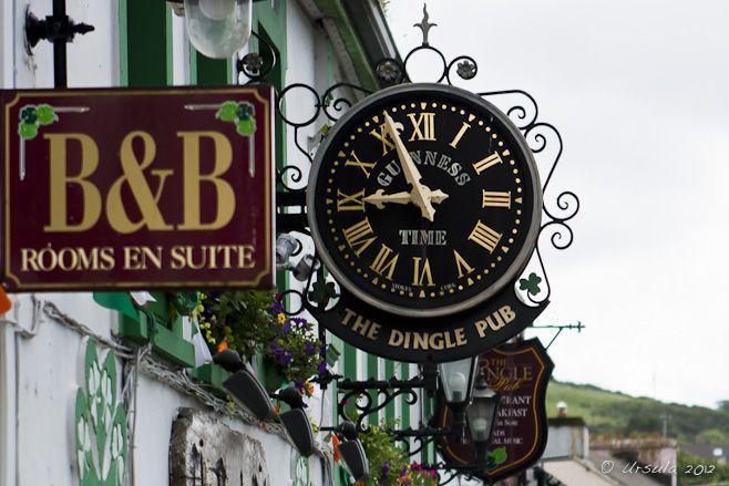 Dingle Ireland Pubs   Ornate clock above the Dingle Pub doorway; B&B sign. Dingle, Ireland