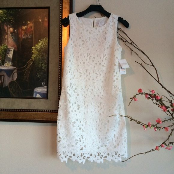Beautiful lace dress This is such a pretty white dress. Very elegant and classy. New with tags Jessica Simpson Dresses