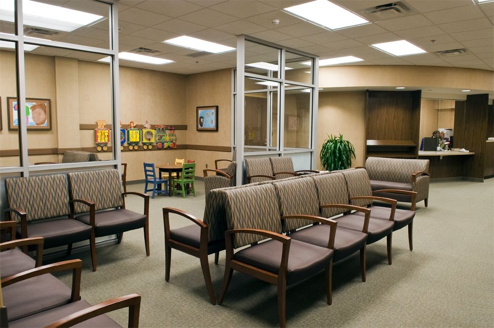 Brown color chairs in medical office waiting room ...