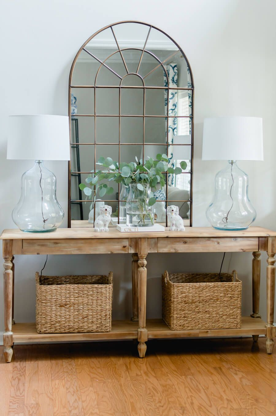 A Pair Of Vintage Glass Lamps In The Entry Entryway Table Decor
