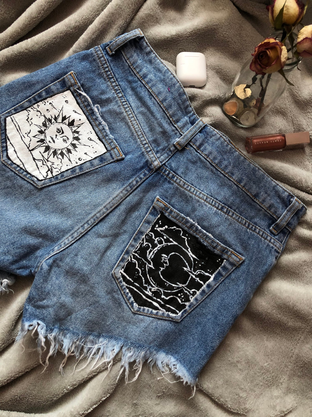 Painted jeans with moon and sun in black and white