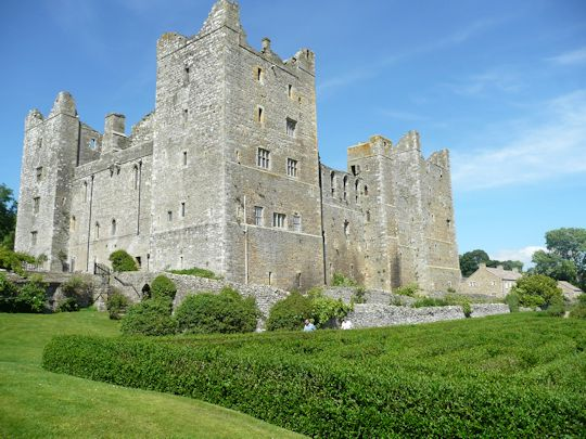 Bolton Castle, where Mary Queen of Scots was imprisoned after losing the Battle of Langside, and maze in the foreground.