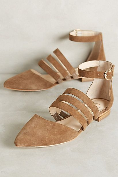 Unusual sandals.. looks like the three bars across the middle of the shoe have elastic, to help with the fit.