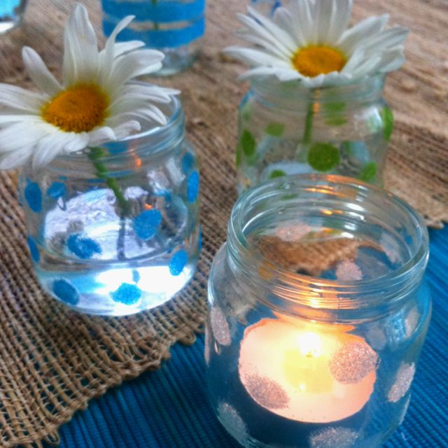 Glitter decorated baby food jars for flowers or tee-candles. Use craft glue and glitter. Easy and fun... And looks beautiful on a table setting.