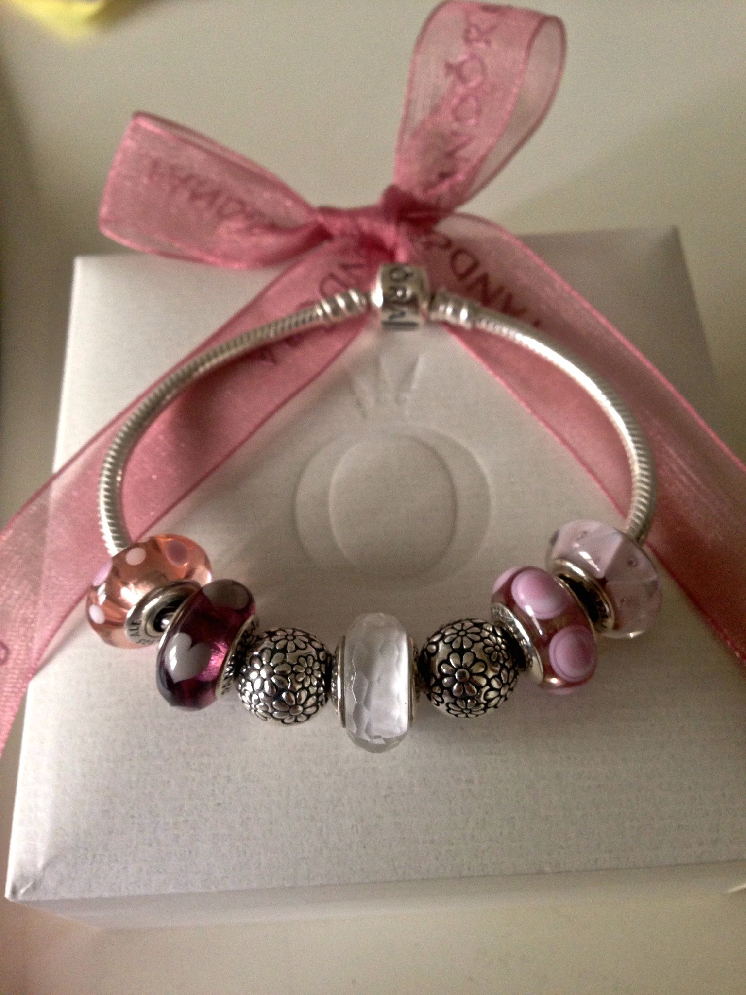 304ebd70a A tasteful Pandora collection of muted pinks, white faceted Murano and a  little silver. Understated.